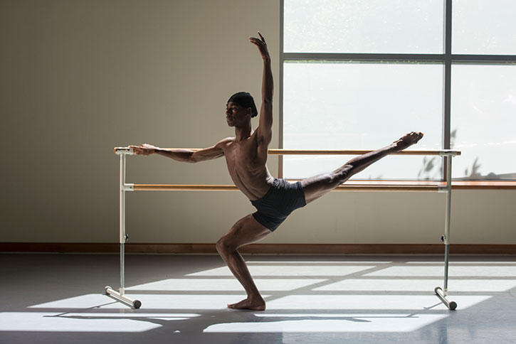 A dance student, Dony'ae Bush, stretches in one of our studios